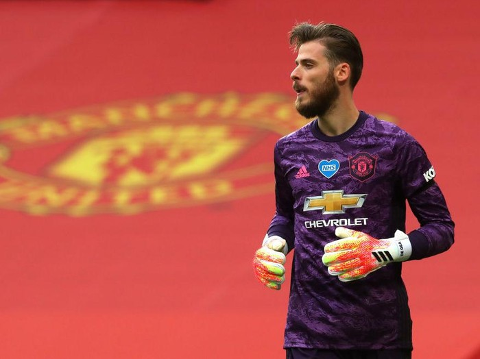 MANCHESTER, ENGLAND - JULY 22: David De Gea of Manchester United looks on during the Premier League match between Manchester United and West Ham United at Old Trafford on July 22, 2020 in Manchester, England. Football Stadiums around Europe remain empty due to the Coronavirus Pandemic as Government social distancing laws prohibit fans inside venues resulting in all fixtures being played behind closed doors. (Photo by Catherine Ivill/Getty Images)