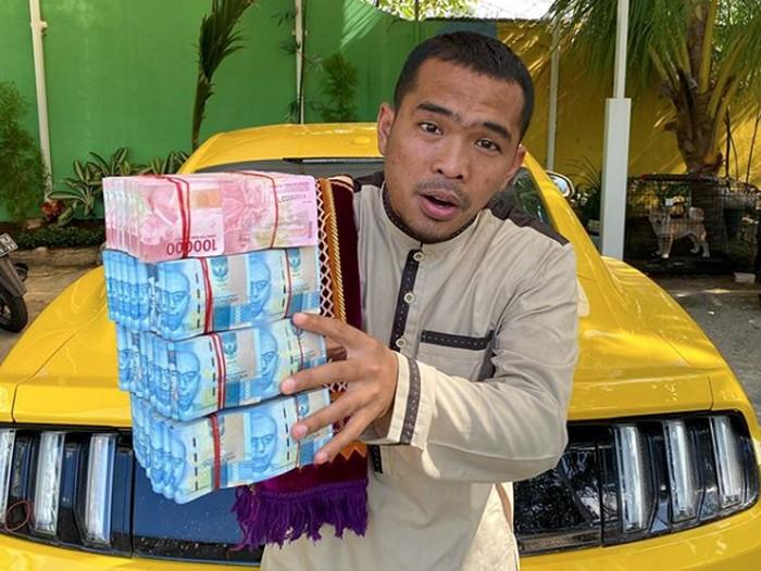 Putra Siregar, pemilik PS Store yang dijadikan tersangka kasus hp ilegal.