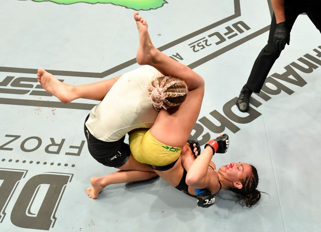 ABU DHABI, UNITED ARAB EMIRATES - JULY 12: In this handout image provided by UFC, (R-L) Amanda Ribas of Brazil secures an arm bar submission against Paige VanZant in their flyweight fight during the UFC 251 event at Flash Forum on UFC Fight Island on July 12, 2020 on Yas Island, Abu Dhabi, United Arab Emirates. (Photo by Jeff Bottari/Zuffa LLC via Getty Images)