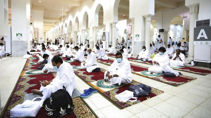 Muslim pilgrims pray inside the Namira Mosque in Arafat as they keep social distance to protect themselves against coronavirus during the annual hajj pilgrimage near the holy city of Mecca, Saudi Arabia, Thursday, July 30, 2020. This years hajj was dramatically scaled down from 2.5 million pilgrims to as few as 1,000 due to the coronavirus pandemic. (AP Photo)