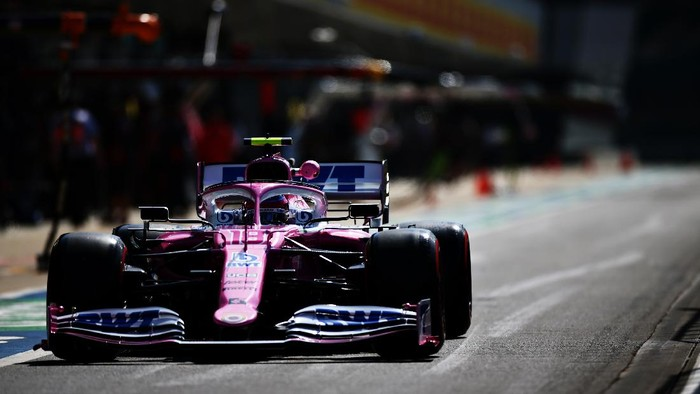 NORTHAMPTON, ENGLAND - JULY 31: Lance Stroll of Canada driving the (18) Racing Point RP20 Mercedes in the Pitlane  during practice for the F1 Grand Prix of Great Britain at Silverstone on July 31, 2020 in Northampton, England. (Photo by Peter Fox/Getty Images)