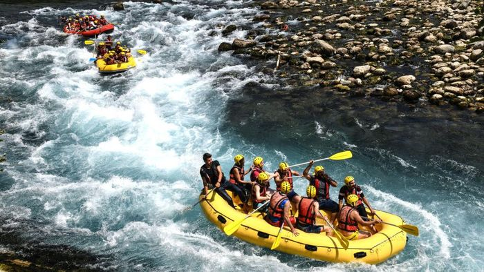 MANAVGAT, TURKEY - AUGUST 18: People take part in white water rafting on the river in Koprulu Canyon on August 18, 2019 in Manavgat, Turkey. Turkey's resort towns saw a 100 percent occupancy rate with the Eid al-Adha holiday, including the southern province of Antalya and Aegean province of Muğla, the top two favorite destinations of both domestic and foreign tourists. According to countrys statistical authority Turkeys tourism revenue hit nearly $8 billion in the second quarter of this year. (Photo by Burak Kara/Getty Images)