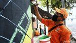 Melihat Mural Kece dari Pasukan Oranye