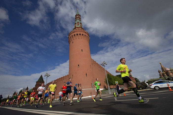 People run past the Kremlin Wall as they take part in a half-marathon in Moscow, Russia, Sunday, Aug., 2, 2020. Around 17,000 people took part in the race. (AP Photo/Alexander Zemlianichenko Jr)