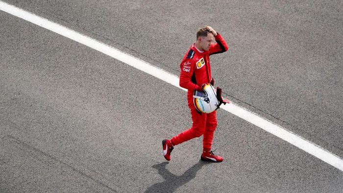 NORTHAMPTON, ENGLAND - AUGUST 02: Sebastian Vettel of Germany and Ferrari reacts in parc ferme during the F1 Grand Prix of Great Britain at Silverstone on August 02, 2020 in Northampton, England. (Photo by Will Oliver/Pool via Getty Images)