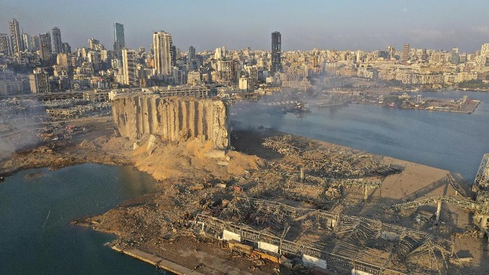 A drone picture shows smoke from the scene of an explosion at the seaport of Beirut, Lebanon, Wednesday, Aug. 5, 2020. A massive explosion rocked Beirut on Tuesday, flattening much of the citys port, damaging buildings across the capital and sending a giant mushroom cloud into the sky. (AP Photo/Hussein Malla)