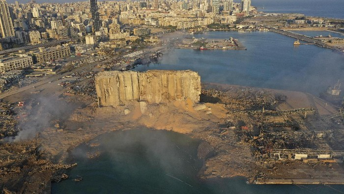 A drone picture shows smoke from the scene of an explosion at the seaport of Beirut, Lebanon, Wednesday, Aug. 5, 2020. A massive explosion rocked Beirut on Tuesday, flattening much of the city's port, damaging buildings across the capital and sending a giant mushroom cloud into the sky. (AP Photo/Hussein Malla)