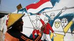 Pasukan Oranye Percantik Ibu Kota dengan Mural Kemerdekaan