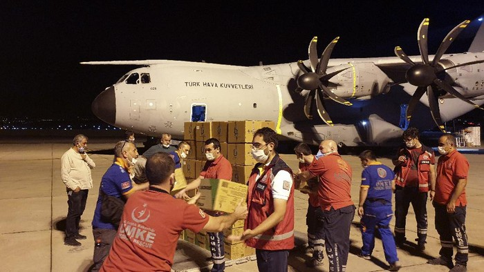 In this photo provided by Turkish Defense Ministry, rescue workers load boxes into a cargo plane at a military airport near Ankara, Turkey, late Wednesday, Aug. 5, 2020. Turkey sent rescue teams and aid to Beirut after an explosion in the Lebanese capitals port killed more than 100 people and injured thousands on Tuesday. (Turkish Defense Ministry via AP, Pool)