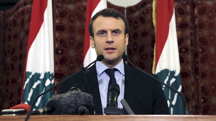 FILE - In this Tuesday, Jan. 24, 2017 file photo, French presidential candidate and former French Economy Minister Emmanuel Macron speaks during a press conference at the Government House, in downtown Beirut, Lebanon. French President Emmanuel Macron is traveling to Lebanon on Thursday Aug. 6, 2020, to offer support for the country after the massive, deadly explosion in Beirut. Lebanon is a former French protectorate and the countries retain close political and economic ties.  (AP Photo/Bilal Hussein, File)