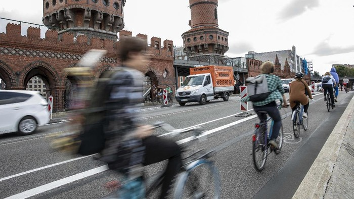 BERLIN, GERMANY - AUGUST 03: Cyclists use a