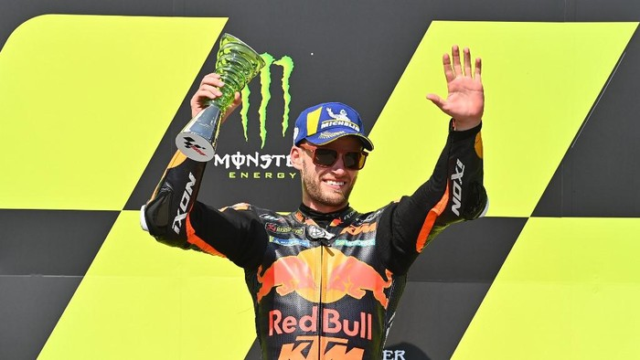 Winner Red Bull KTM Factory Racings South African Brad Binder celebrates during the winners ceremony after the Moto GP Czech Grand Prix at Masaryk circuit in Brno on August 9, 2020. (Photo by Joe Klamar / AFP)