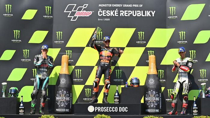 (L-R) Second placed Petronas Yamaha SRTs Italian rider Franco Morbidelli, winner Red Bull KTM Factory Racings South African Brad Binder and third placed Esponsorama Racings French rider Johann Zarco celebrate on the podium after the Moto GP Czech Grand Prix at Masaryk circuit in Brno on August 9, 2020. (Photo by Joe Klamar / AFP)