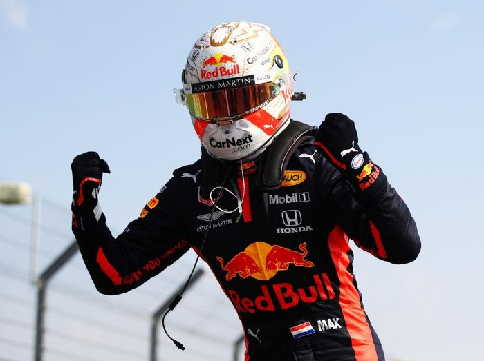 NORTHAMPTON, ENGLAND - AUGUST 09: Race winner Max Verstappen of Netherlands and Red Bull Racing celebrates in parc ferme during the F1 70th Anniversary Grand Prix at Silverstone on August 09, 2020 in Northampton, England. (Photo by Bryn Lennon/Getty Images)