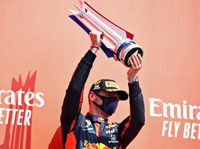 NORTHAMPTON, ENGLAND - AUGUST 09: Race winner Max Verstappen of Netherlands and Red Bull Racing celebrates on the podium during the F1 70th Anniversary Grand Prix at Silverstone on August 09, 2020 in Northampton, England. (Photo by Mark Thompson/Getty Images)