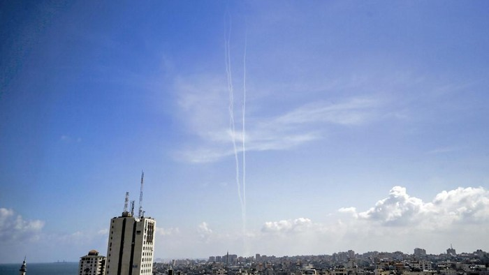 This picture taken on August 10, 2020 from Gaza City shows a view of smoke trails from test rockets fired by the Palestinian Islamist Hamas movement which currently controls the Gaza Strip, as part of military drills. - The rockets were a