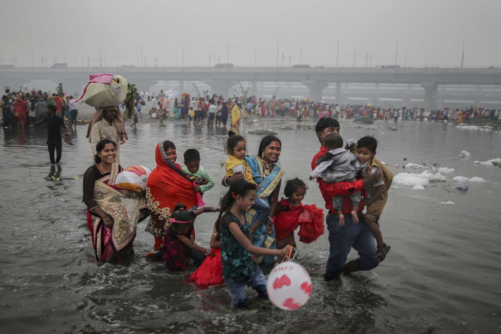 Hindu pilgrims spend the night huddled together after being forced by high tide to flee from their camps on the eve of Makar Sankranti festival on Sagar Island, an island in the Ganges delta, in the eastern Indian state of West Bengal, Tuesday, Jan. 14, 2020. Sagar and many other small islands which are part of the Sundarbans, the world's largest mangrove forest, have seen a dramatic rise in sea levels due to climate change. The highest point in the Sundarbans is around 3 meters (9.8 feet) and the mean elevation is less than a meter above sea level. (AP Photo/Altaf Qadri)