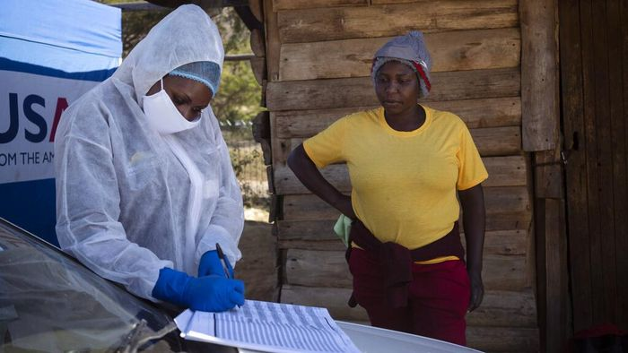 A nurse stands next to a HIV-positive patient outside a gazebo used as a mobile HIV clinic in Ngodwana, South Africa, Thursday, July 2, 2020. Across Africa and around the world, the COVID-19 pandemic has disrupted the supply of antiretroviral drugs to many of the more than 24 million people who take them, endangering their lives. An estimated 7.7 million people in South Africa are HIV positive, the largest number in the world, and 62% of them take the antiretroviral drugs that suppress the virus and prevent transmission. (AP Photo/Bram Janssen)
