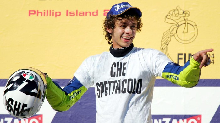 PHILLIP ISLAND, AUSTRALIA - OCTOBER 17:  Valentino Rossi of Italy and the Gauloises Fortuna Yamaha Team celebrates after the Australian Motorcycle Grand Prix which is round fifteen of the MotoGP World Championship at Phillip Island Grand Prix Circuit on October 17, 2004 in Phillip Island, Australia. (Photo by Ryan Pierse/Getty Images)