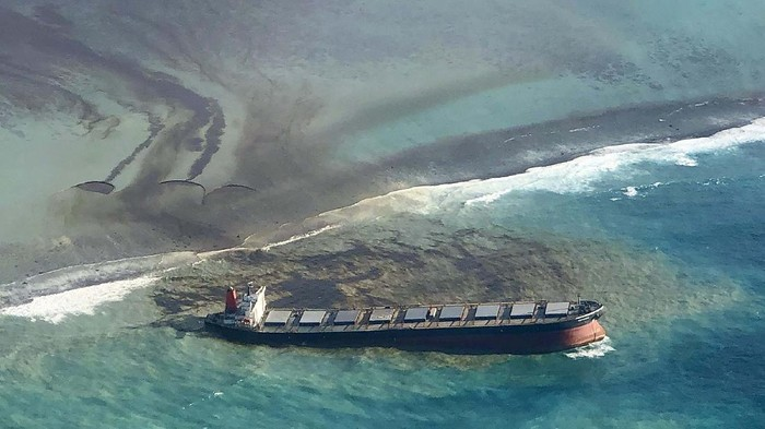 This photo provided by the Mauritian Wildlife Foundation Ministry shows oil leaking from the MV Wakashio, a bulk carrier ship that recently ran aground off the southeast coast of Mauritius, Monday Aug. 10, 2020. The Indian Ocean island of Mauritius has declared a state of environmental emergency after the Japanese-owned ship that ran aground offshore days ago began spilling tons of fuel. (Nik Cole/Mauritian Wildlife Foundation via AP)