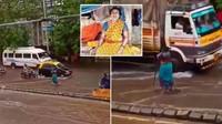 Wanita Ini Berdiri 7 Jam di Depan Lubang Got saat Jalanan Banjir, Ngapain?