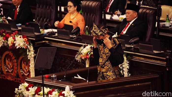 Presiden Joko Widodo (Jokowi) menyampaikan pidato di Sidang Tahunan MPR-DPR-DPD, Jumat (14/8/2020). Dalam pidatonya, ia mengatakan pemerintah tak pernah main-main untuk memberantas korupsi.