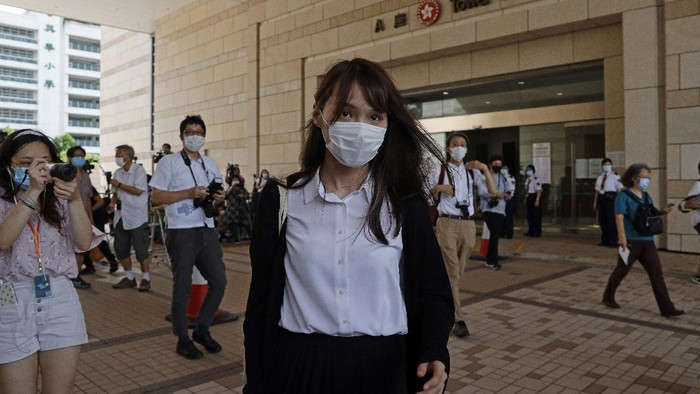 Pro-democracy activist Agnes Chow walks out from a court in Hong Kong, Wednesday, Aug. 5, 2020. Chow appeared for sentencing after she pleaded guilty to inciting others to participate in an unlawful assembly, as well as to participating in an unauthorized assembly, related to protests in June last year.