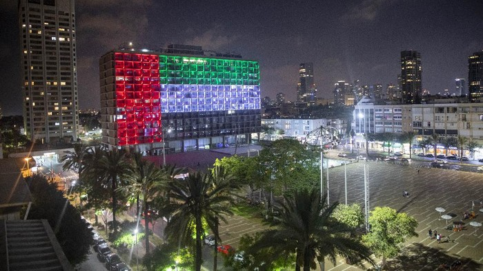 Tel Aviv City Hall is lit up with the flags of the United Arab Emirates and Israel as the countries announced they would be establishing full diplomatic ties, in Tel Aviv, Israel, Thursday, Aug. 13, 2020. In a nationally broadcast statement, Prime Minister Benjamin Netanyahu said the