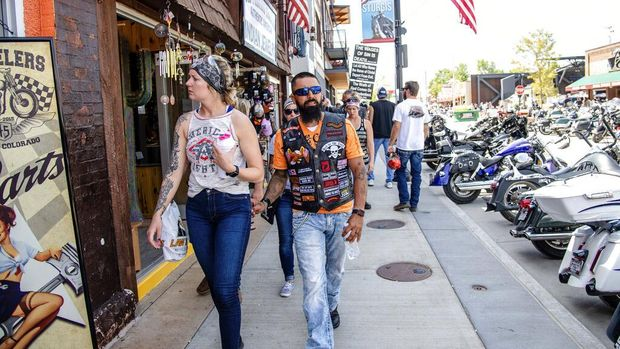 Bikers walk down Main Street during the 80th annual Sturgis Motorcycle Rally on Saturday, Aug. 15, 2020, in Sturgis, S.D. (Amy Harris/Invision/AP)