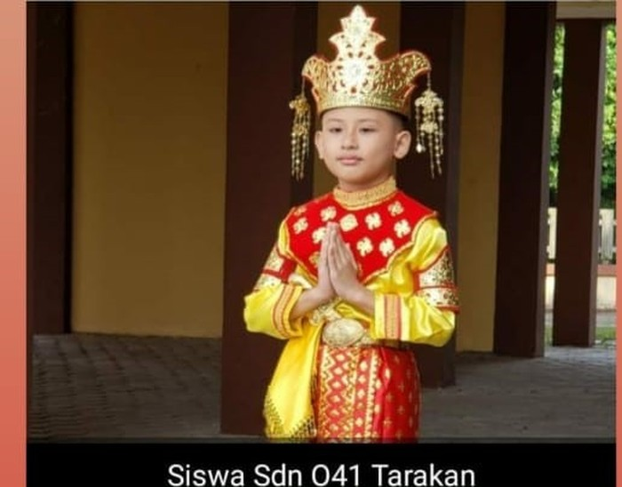 Seorang anak dengan baju Tidung menjadi model uang baru (dok. Istimewa)