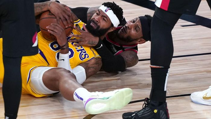 Los Angeles Lakers forward Markieff Morris battles on the floor for a loose ball with Portland Trail Blazers forward Carmelo Anthony , beneath, during the second half of an NBA basketball game Tuesday, Aug. 18, 2020, in Lake Buena Vista, Fla. (AP Photo/Ashley Landis, Pool)