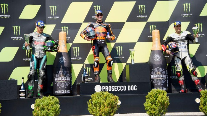 BRNO, CZECH REPUBLIC - AUGUST 09: (L-R) Franco Morbidelli of Italy and Petronas Yamaha SRT, Brad Binder of South Africa and Red Bull KTM Factory Racing  and Johann Zarco of France and Reale Avintia Racing celebrate on the podium  at the end of the MotoGP race during the MotoGP Of Czech Republic at Brno Circuit on August 09, 2020 in Brno, Czech Republic. (Photo by Mirco Lazzari gp/Getty Images)