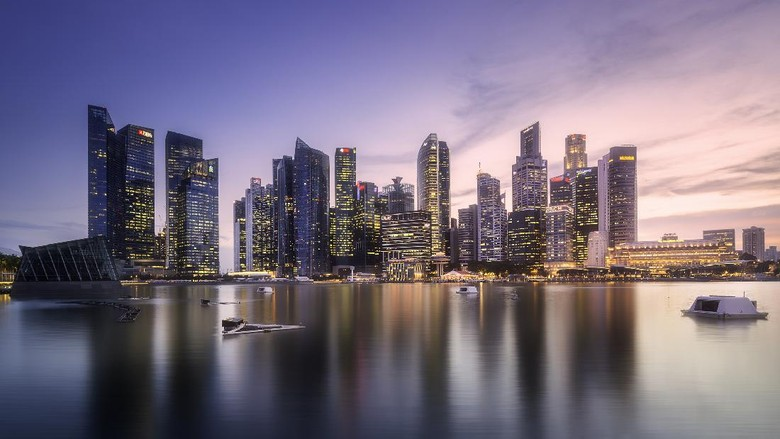 View of downtown district and Marina bay skyline with purple sunrise in Singapore