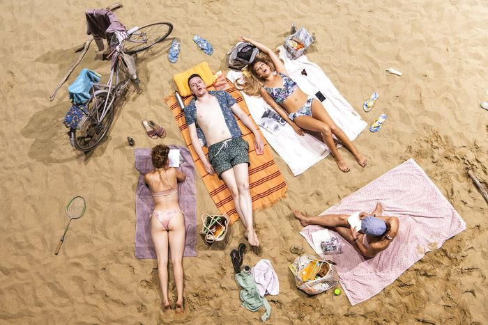 Beach guests with microphones, sing a never-ending opera entitled