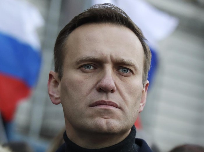 "FILE - In this file photo taken on Saturday, Feb. 29, 2020, Russian opposition activist Alexei Navalny takes part in a march in memory of opposition leader Boris Nemtsov in Moscow, Russia. The German hospital treating Russian dissident Alexei Navalny says tests indicate that he was poisoned. The Charité hospital said in a statement Monday, Aug. 24, 2020 that the team of doctors who have been examining Navalny since he was admitted Saturday have found the presence of ""cholinesterase inhibitors"" in his system. Cholinesterase inhibitors are a broad range of substances that are found in several drugs, but also pesticides and nerve agents. (AP Photo/Pavel Golovkin, File)"