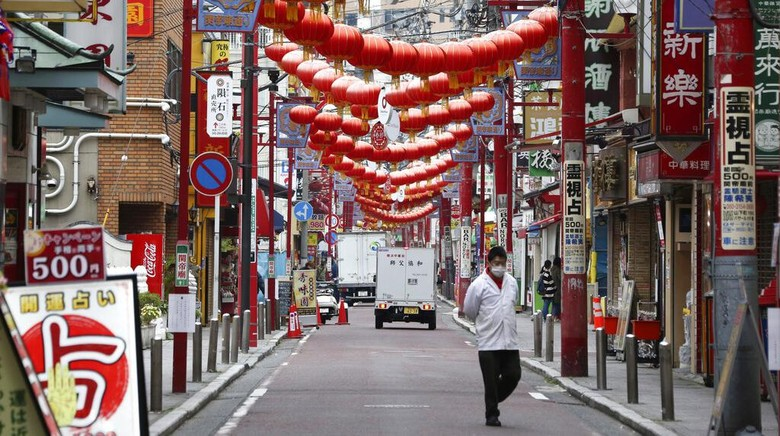 A woman walks in the empty Asakusa district, usually popular with tourists, Wednesday, April 1, 2020, in Tokyo. The United Nations Secretary-General Antonio Guterres on Tuesday, Aug. 25, 2020, said the global tourism industry has been devastated by the coronavirus pandemic, with $320 billion lost in exports in the first five months of the year and more than 120 million jobs at risk. (AP Photo/Eugene Hoshiko, File)