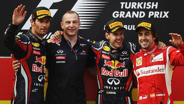 ISTANBUL, TURKEY - MAY 08:  Race winner Sebastian Vettel (2nd right) of Germany and Red Bull Racing celebrates on the podium with second placed Mark Webber (left) of Australia and Red Bull Racing, third placed Fernando Alonso (right) of Spain and Ferrari and Red Bull Racing team mate Mark Ellis (2nd left) following the Turkish Formula One Grand Prix at the Istanbul Park circuit on May 8, 2011 in Istanbul, Turkey.  (Photo by Bryn Lennon/Getty Images)