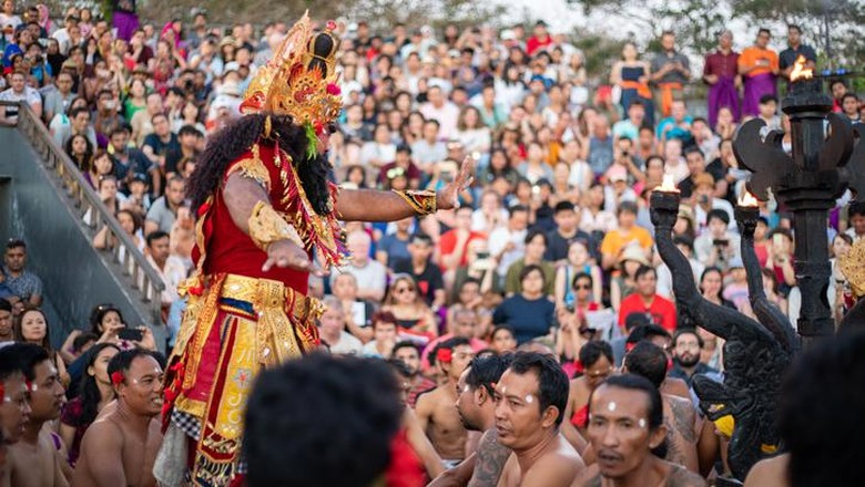 Bali, Indonesia - June 5, 2013: Traditional Ritual Balinese Kecak dance with elements of trance performed by men artists in traditional costumes  at Uluwatu Temple in the evening.