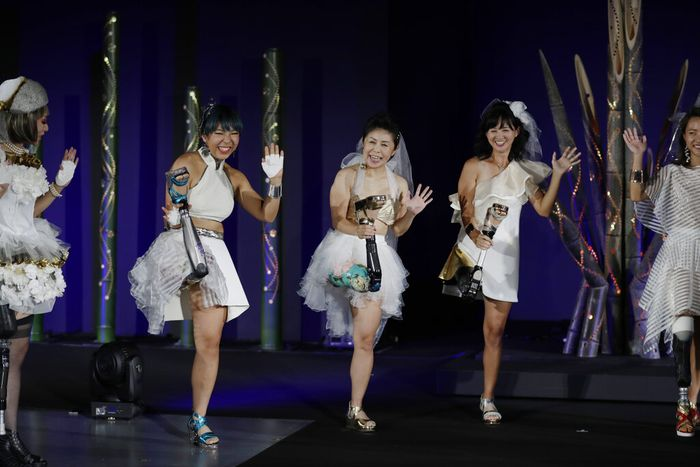 Kaede Maegawa, a Paralympian, from second left, Hitomi Onishi, a Paralympian, and Sayaka Murakami, an athlete, pose for a photo at the end of a fashion show dubbed