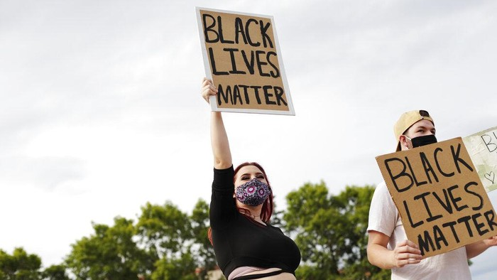 Kenzie Medick, 19, and Patrick Eades, 22, hold Black Lives Matter signs during the Justice for Jacob protest near the south side of the Marathon County Courthouse, Tuesday, Aug. 25, 2020, in Wausau, Wis. (Samantha Madar/The Post-Crescent via AP)