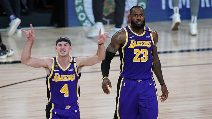 Los Angeles Lakers guard Alex Caruso (4) and forward LeBron James (23) celebrate their win over the Portland Trail Blazers in an NBA basketball first round playoff game, Saturday, Aug. 22, 2020, in Lake Buena Vista, Fla. (AP Photo/Ashley Landis, Pool)
