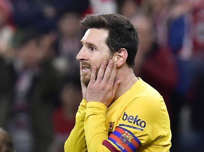FILE - In this Feb. 6, 2020 file photo, Barcelonas Lionel Messi reacts during the Spanish Copa del Rey, quarter final, soccer match against Athletic Bilbao at the San Mames stadium in Bilbao, Spain. Lionel Messi has told Barcelona he wants to leave the club after nearly two decades with the Spanish giants. The club has confirmed that the Argentina great has sent a note expressing his desire to leave. The announcement comes 11 days after Barcelonas humiliating 8-2 loss to Bayern Munich in the Champions League quarterfinals, one of the worst in the players career and in the clubs history. (AP Photo/Alvaro Barrientos, File)