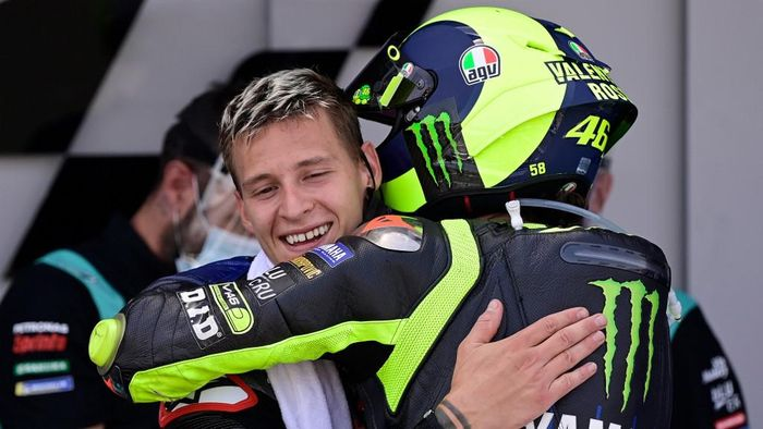 Petronas Yamaha SRTs French rider Fabio Quartararo (L) is congratulated by Monster Energy Yamahas Italian rider Valentino Rossi after winning the MotoGP race during the Andalucia Grand Prix at the Jerez race track in Jerez de la Frontera on July 26, 2020. (Photo by JAVIER SORIANO / AFP)