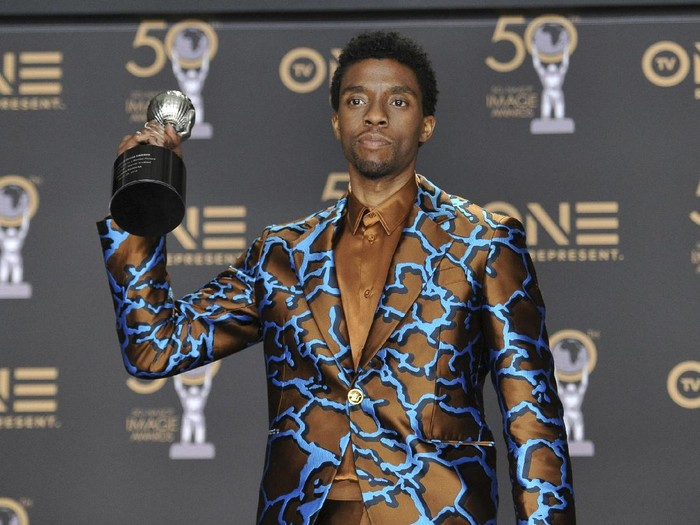 FILE - In this Saturday, March 30, 2019 file photo, Chadwick Boseman poses in the press room with the award for outstanding actor in a motion picture for Black Panther at the 50th annual NAACP Image Awards at the Dolby Theatre in Los Angeles. Actor Chadwick Boseman, who played Black icons Jackie Robinson and James Brown before finding fame as the regal Black Panther in the Marvel cinematic universe, has died of cancer. His representative says Boseman died Friday, Aug. 28, 2020 in Los Angeles after a four-year battle with colon cancer. He was 43. (Photo by Richard Shotwell/Invision/AP, File)