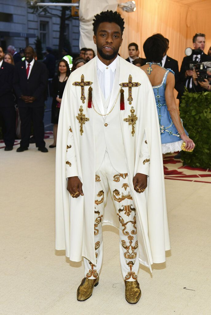 FILE - In this May 7, 2018 file photo, Chadwick Boseman attends The Metropolitan Museum of Art's Costume Institute benefit gala celebrating the opening of the Heavenly Bodies: Fashion and the Catholic Imagination exhibition in New York.  Boseman, who played Black icons Jackie Robinson and James Brown before finding fame as the regal Black Panther in the Marvel cinematic universe, has died of cancer. His representative says Boseman died Friday, Aug. 28, 2020 in Los Angeles after a four-year battle with colon cancer. He was 43. (Photo by Charles Sykes/Invision/AP, File)