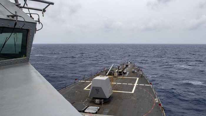 The Arleigh Burke-class guided-missile destroyer USS Mustin (DDG 89) conducts routine operations in the South China Sea. Mustin is forward-deployed to the U.S. 7th Fleet area of operations in support of security and stability in the Indo-Pacific region. (U.S. Navy photo by Mass Communication Specialist 3rd Class Cody Beam)