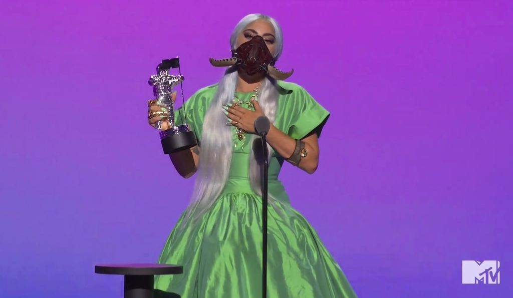 This combination photo of video grabs by MTV, issued Sunday, Aug. 30, 2020, shows Lady Gaga wearing masks during the MTV Video Music Awards. (MTV via AP)