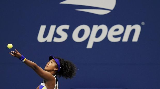 Naomi Osaka, of Japan, serves to Misaki Doi, of Japan, during the first round of the US Open tennis championships, Monday, Aug. 31, 2020, in New York. (AP Photo/Frank Franklin II)