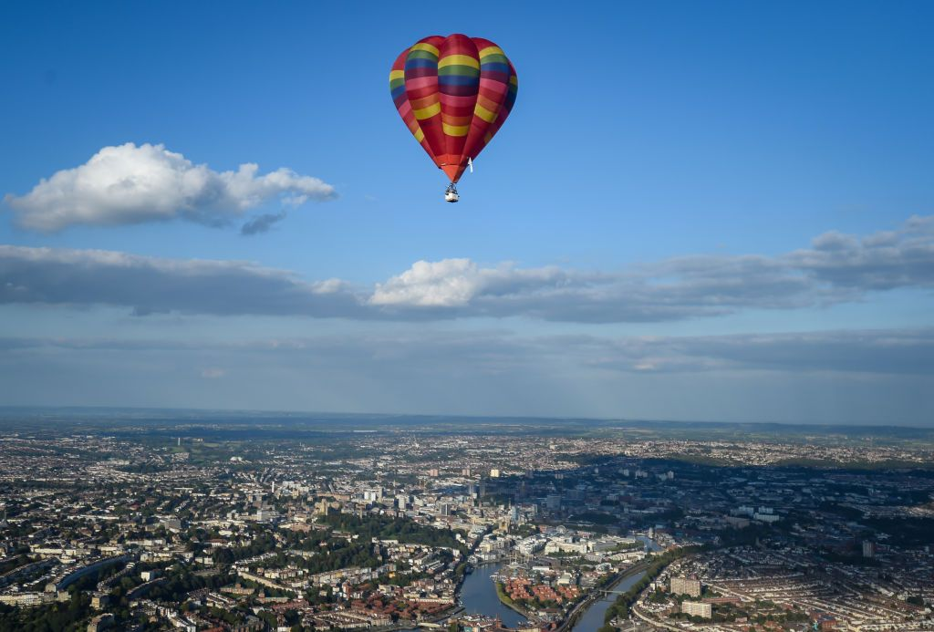 BRISTOL, ENGLAND - SEPTEMBER 01: A shadow of a balloon is seen as musician Jerome Gamble plays guitar to accompany the recorded music as it is played to the city below on September 01, 2020 in Bristol, England. Created by Bristol-based artist Luke Jerram and composer Dan Jones,