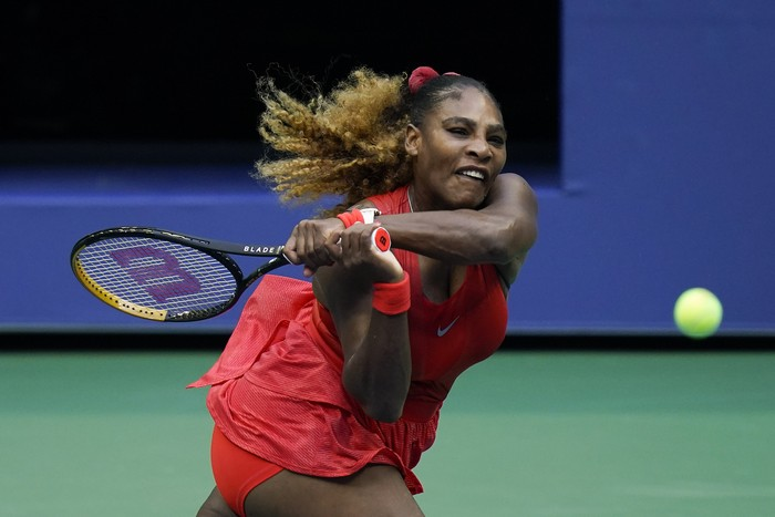 Serena Williams, of the United States, returns a shot to Kristie Ahn, of the United States, during the first round of the US Open tennis championships, Tuesday, Sept. 1, 2020, in New York. (AP Photo/Seth Wenig)